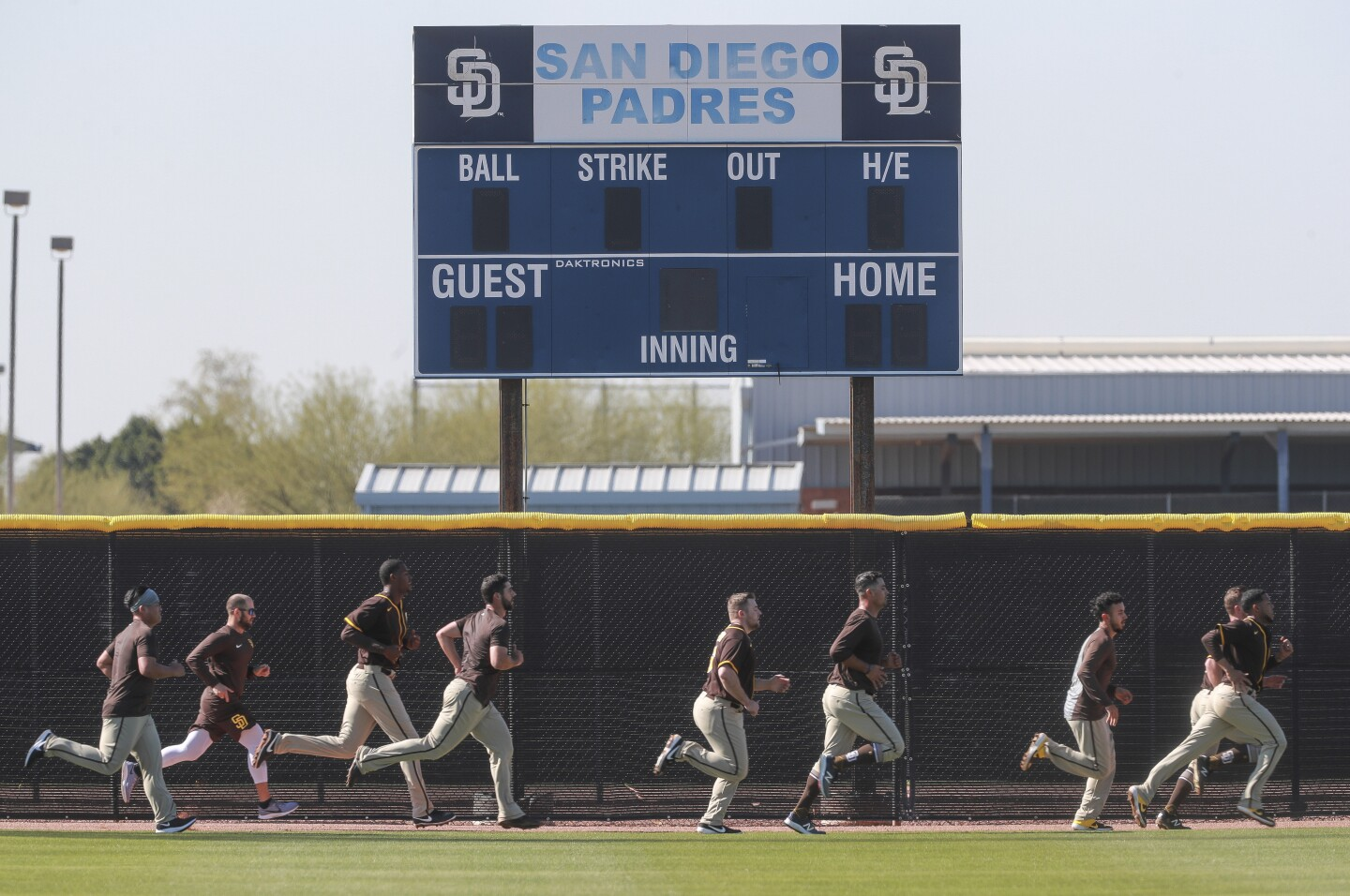 Padres players run during Padres spring training at the Peoria Sports Complex on Thursday, February 13, 2020 in Peoria, Arizona.