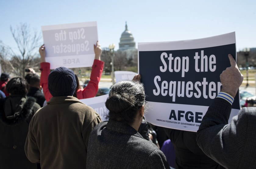 Members of the American Federation of Government Employees gather during a rally outside the Department of Labor in Washington, D.C. Some Republican lawmakers are also complaining about the sequester.