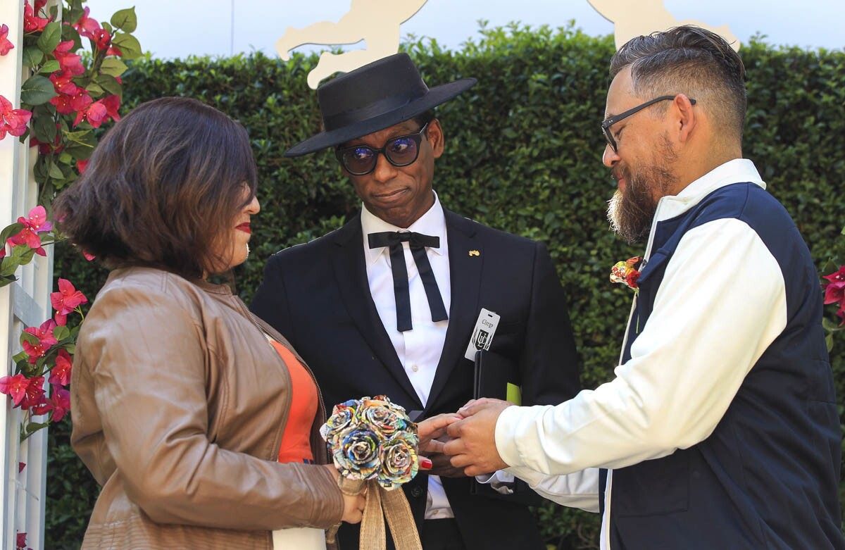 Comedian and actor Orlando Jones marries Melissa Martinez and Esteban Martinez at the SYFY Geek Love Chapel on 5th Avenue in downtown San Diego on Thursday. (Hayne Palmour IV/Union-Tribune)