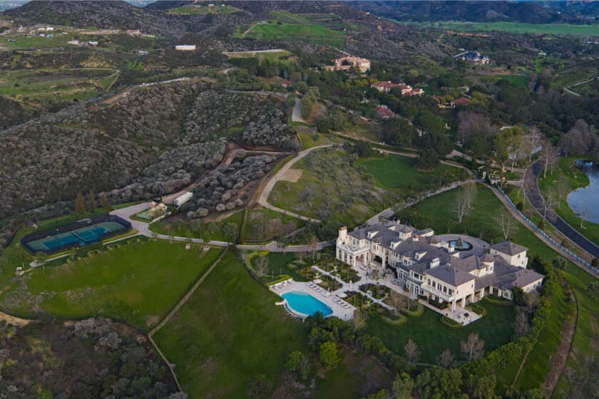 The 20-acre estate centers on a French-inspired mansion with seven bedrooms and 14 bathrooms spread across 14,000 square feet.
