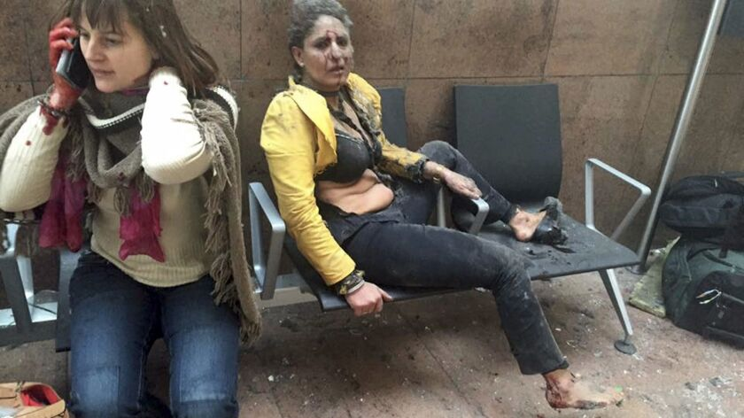 Nidhi Chaphekar, a 40-year-old Jet Airways flight attendant from Mumbai, right, and an unidentified woman sit on chairs after being wounded in explosions at the airport in Brussels, Belgium.
