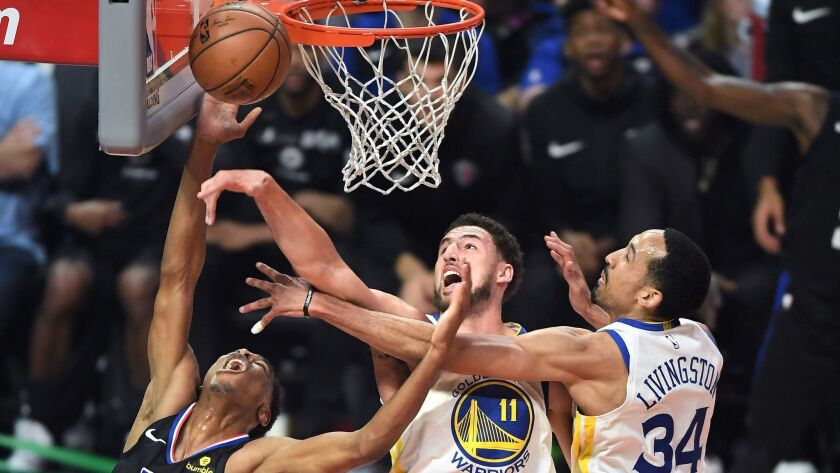 LOS ANGELES, CALIFORNIA APRIL 26, 2019-Clippers Shai Gilgeous-Alexander has his shot blocked by Warr