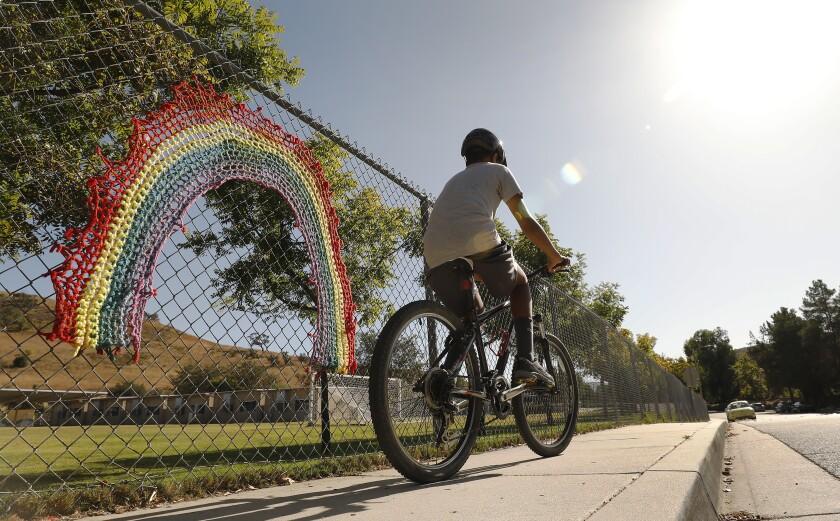 Rainbow on fence