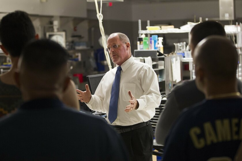 At the San Diego Medical Examiners Office, Chaplain Joe Davis addresses a group criminals and offenders about drug and alcohol abuse and other dangerous behaviors to make the point that they could end up in the morgue.