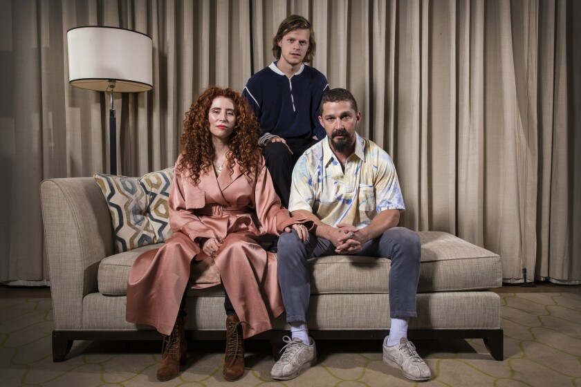 "This Oct. 5, 2019 photo shows, from left, director Alma Har'el, actor Lucas Hedges and actor Shia LaBeouf posing for a portrait to promote their film ""Honey Boy"" during the London Film Festival. (Photo by Joel C Ryan/Invision/AP)"