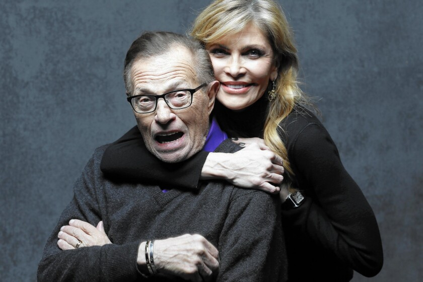 Larry King, pictured with his wife, Shawn, keeps his mind and body busy.