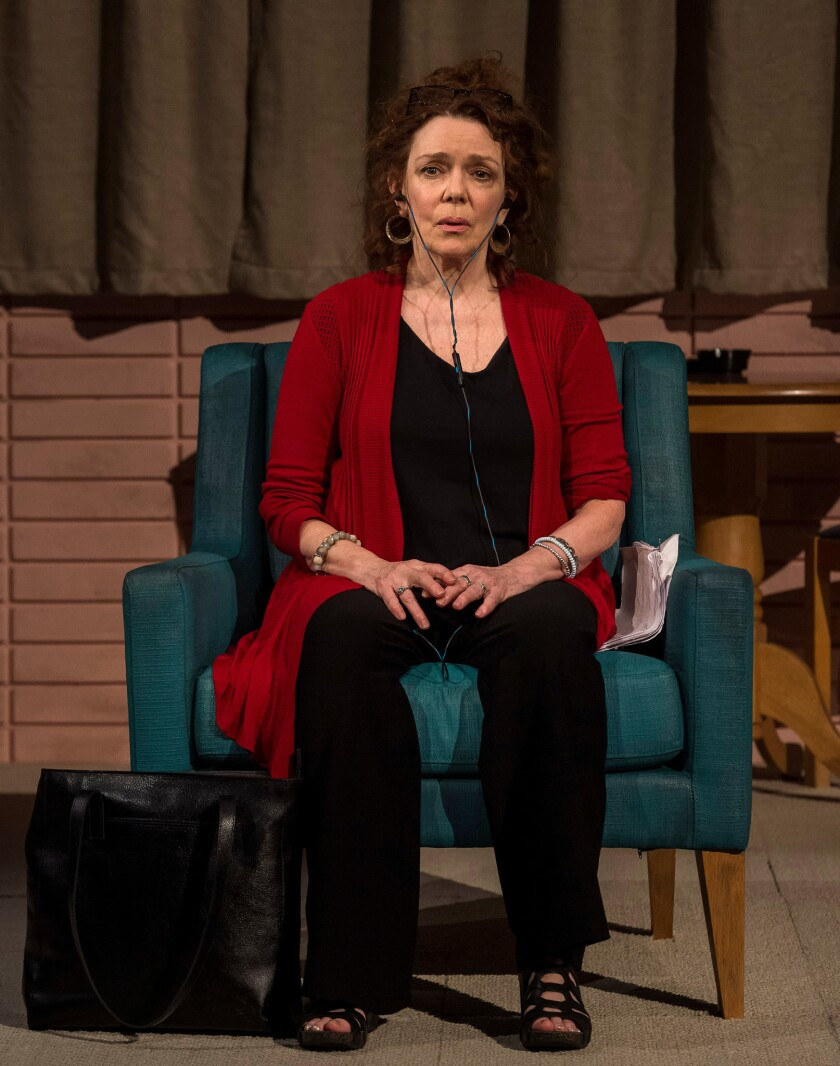 "Deirdre O'Connell, sitting in a chair and wearing earbuds, in the world premiere of Lucas Hnath's ""Dana H."" at the Kirk Douglas Theatre in Culver City."