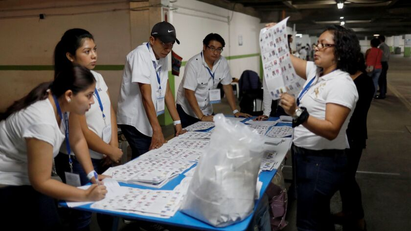Election board officials count the votes after the closing of the electoral polls in Guatemala City on Sunday.