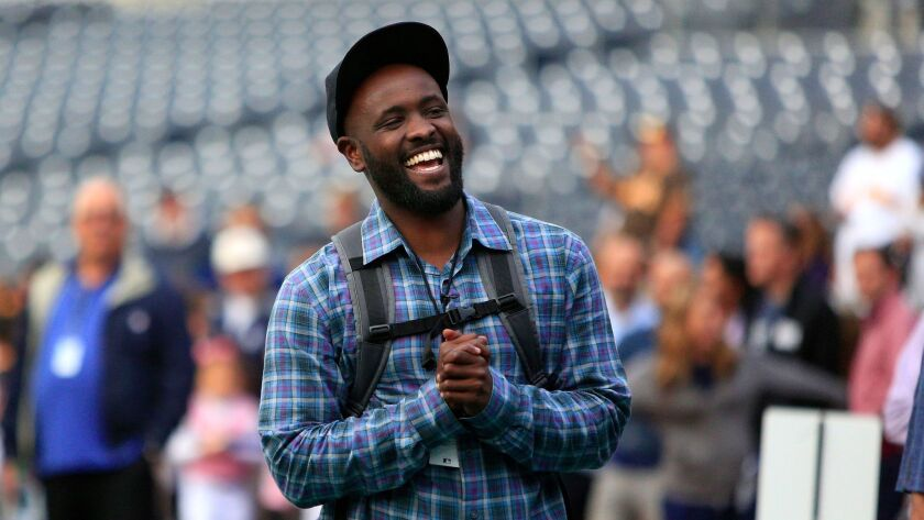 Tony Gwynn Jr. hangs out before the start of a game between the Padres and the Dodgers.