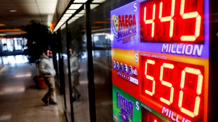 A sign at a store in Atlanta displays the Powerball and Mega Millions jackpots on Thursday,
