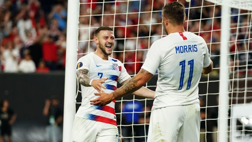 Paul Arriola, left, and Jordan Morris of the U.S. celebrate Arriola's goal in the Americans' 6-0 victory over Trinidad and Tobago in the CONCACAF Gold Cup on Saturday night in Cleveland.