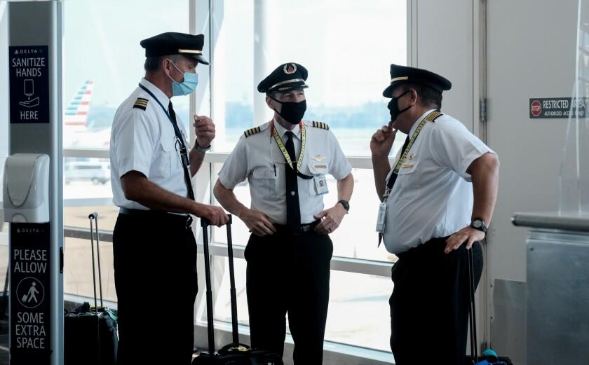 Pilots talking after exiting a Delta Airlines flight at the Ronald Reagan National Airport.