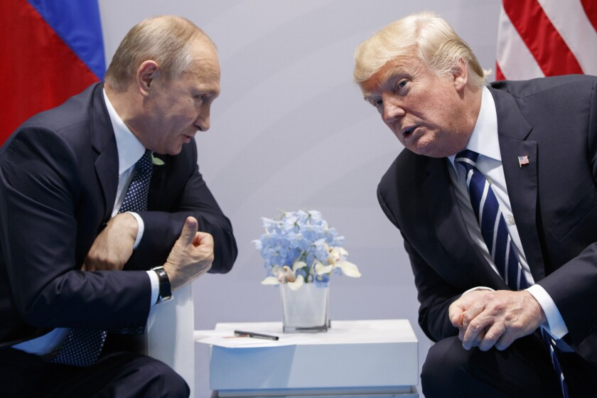 President Trump and Vladimir Putin lean in as they chat at the 2017 G-20 summit.