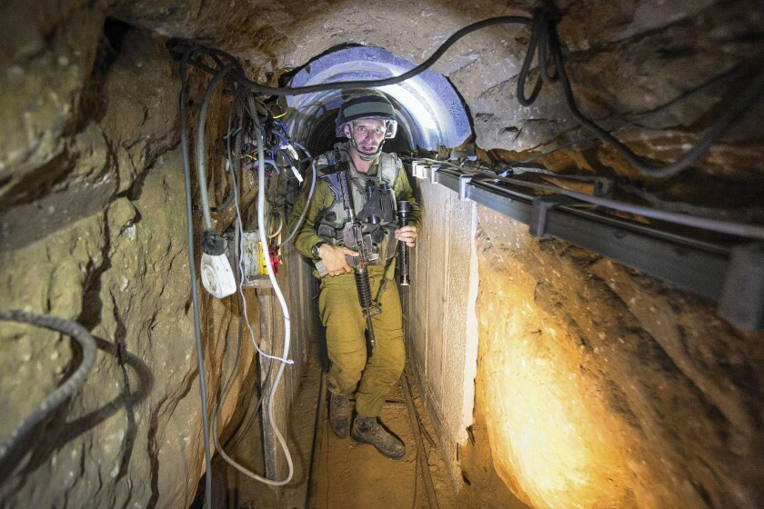 An Israeli army officer gives journalists a tour of a tunnel officials said was used by Palestinian militants for cross-border attacks.