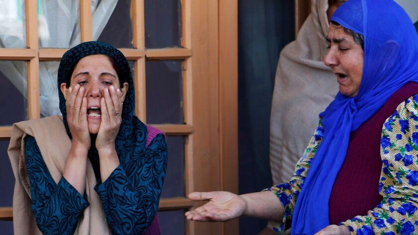 Ghulam Mohd Khan family members cry during his funeral in Srinagar, India, Monday, May 1, 2017. Khan