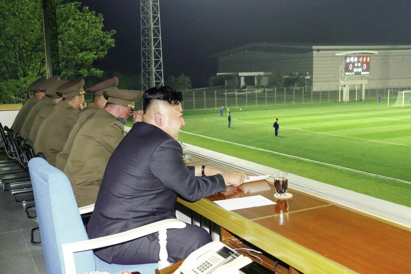 North Korean leader Kim Jong Un watches a soccer game Friday at an undisclosed location.
