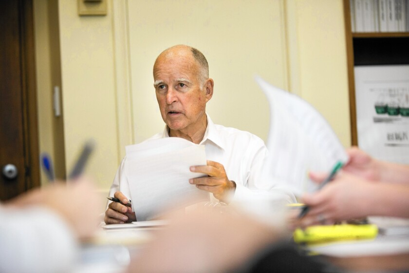 The withdrawal of state Sen. Fran Pavley's bill came a day after Gov. Jerry Brown, above, and legislative leaders withdrew a key portion of another proposal to combat climate change.