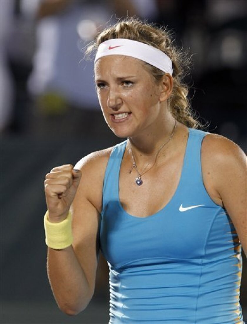 Victoria Azarenka, of  Belarus, celebrates her 1-6, 7-6 (7), 7-5 win over Dominika Cibulkova, of Slovakia, during the Sony Ericsson Open tennis tournament in Key Biscayne, Fla., Monday, March 26, 2012. (AP Photo/Alan Diaz)
