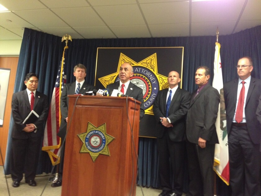 San Bernardino County Dist. Atty. Michael Ramos announces charges against two men associated with the airport authority.