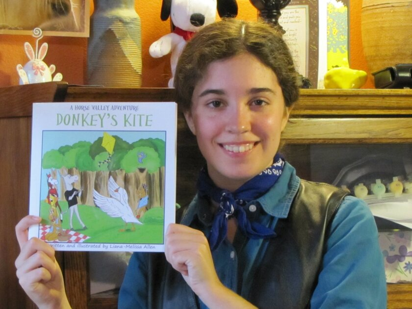 Liana-Melissa Allen with one of the books in her series, 'Donkey's Kite: A Horse Valley Adventure.'