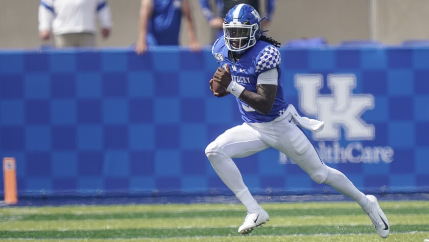 FILE - Kentucky quarterback Terry Wilson (3) carries the ball against Toledo during an NCAA college football game, Saturday, Aug., 31, 2019, in Lexington, Ky. An offense that relied heavily on Lynn Bowden's running aims to pass more again with QB Terry Wilson's return from a season-ending left knee injury sustained in last year's second game. (AP Photo/Bryan Woolston, File)
