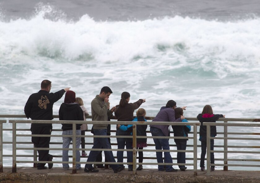 People watch the surf on the jetty of the Children's Pool in La Jolla in March 2012.