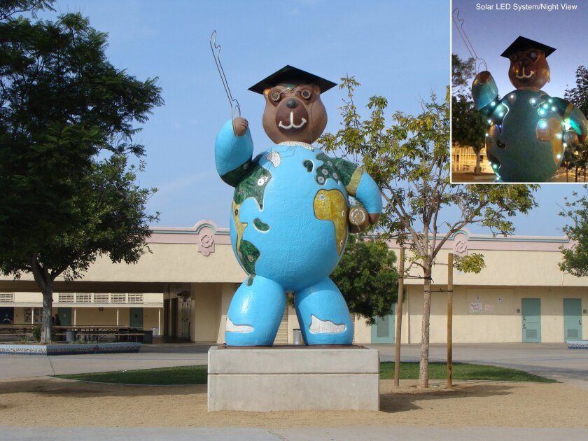 "Sculptor Sergey Gornushkin's sculpture of a  teddy bear holding a graduation cap and diploma reminds students at Theodore Roosevelt Middle School in San Diego of the ""Key to Success."""