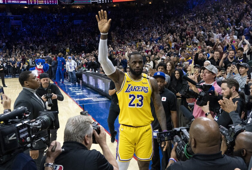 Lakers forward LeBron James acknowledges the fans' ovation after passing Kobe Bryant for No. 3 on the NBA's all-time scoring list during a game Jan. 25, 2020, in Philadelphia.