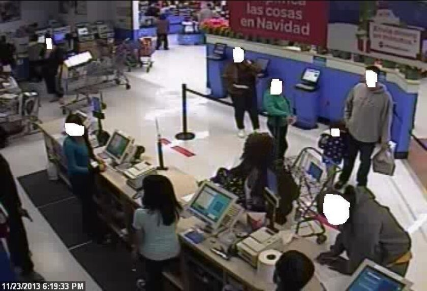 The robber shown at a store service counter.