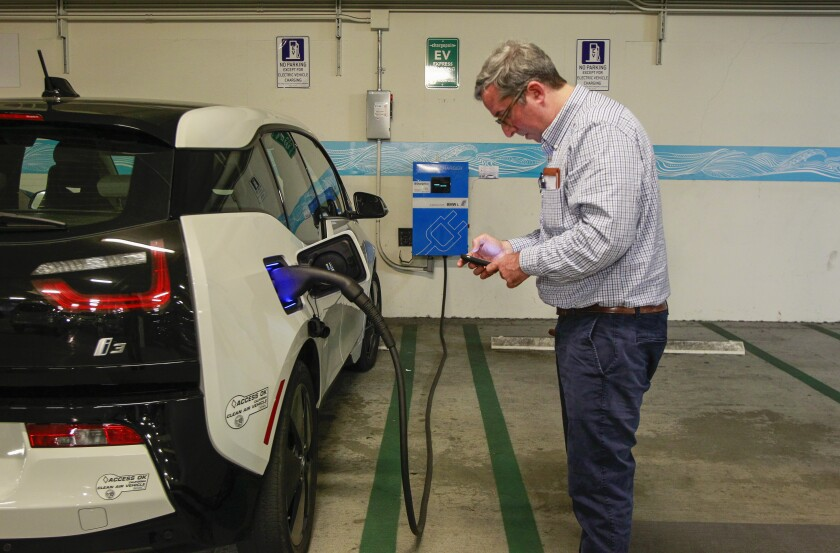 Dan Jacobson tries to charge electric vehicle