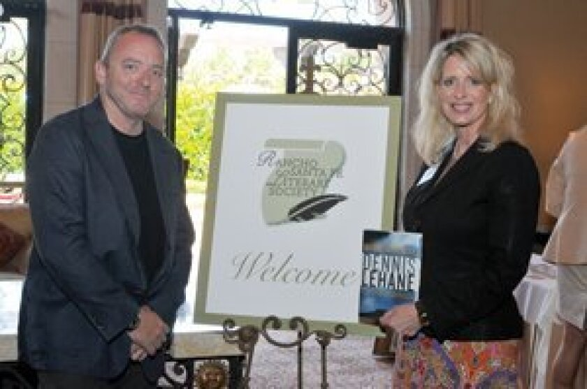 Author Dennis Lehane with chapter coordinator Kelly Colvard. Photo/Rob McKenzie