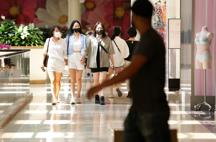 Shoppers at South Coast Plaza in Costa Mesa on Tuesday, June 15, 2021.