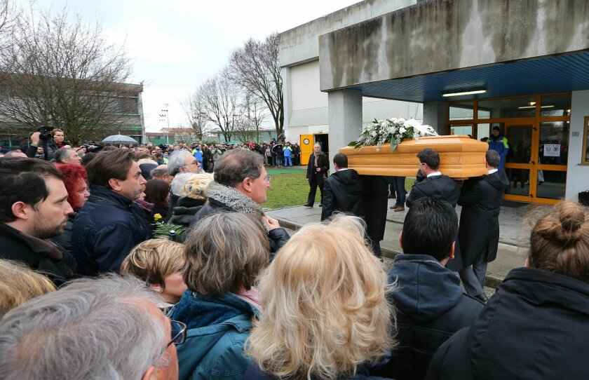 FILE - In this Friday, Feb. 12, 2016 file photo, The coffin of Giulio Regeni arrives at the church for his funeral service in Fiumicello, Northern Italy. Egypt on Monday, Feb. 15, 2016 denied reports that an Italian doctoral student doing research in Cairo was arrested shortly before his death and
