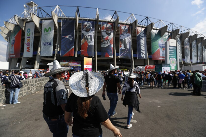 Fans arrive at Azteca stadium in Mexico City before an NFL football game between the Oakland Raiders and the New England Patriots on Nov. 19, 2017.