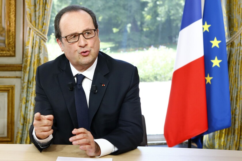 French President Francois Hollande gestures after a televised interview at the Elysee Palace following the Bastille Day parade in Paris on July 14.