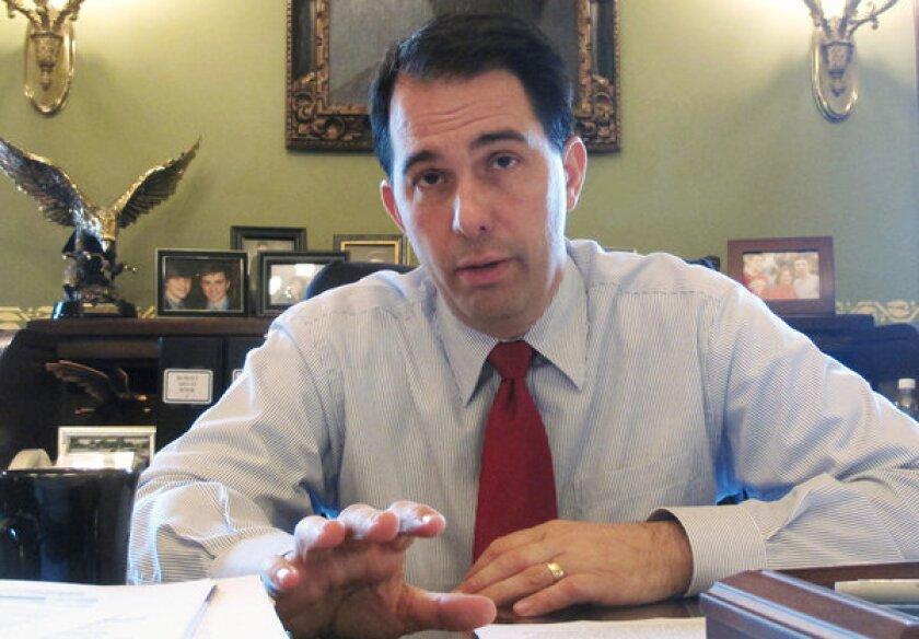 Last month, Wisconsin Gov. Scott Walker signed legislation restricting abortions. Above, Walker in June.