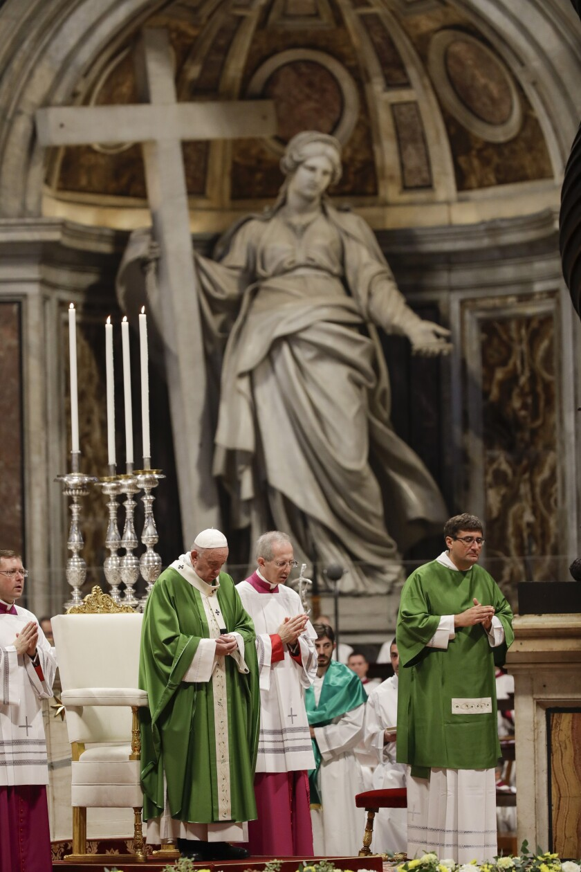Pope Francis celebrates a Mass in St. Peter Basilica at the Vatican, Sunday, Nov. 17, 2019. Pope Francis is offering several hundred poor people, homeless, migrants, unemployed a lunch on Sunday as he celebrates the World Day of the Poor with a concrete gesture of charity in the spirit of his namesake, St. Francis of Assisi. (AP Photo/Alessandra Tarantino)