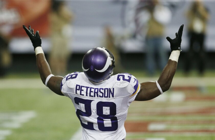 Minnesota Vikings running back Adrian Peterson (28) celebrates his touchdown against the Atlanta Falcons during the second half of an NFL football game, Sunday, Nov. 29, 2015, in Atlanta. (AP Photo/Butch Dill)