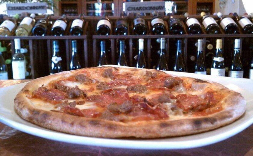 Dolce Pane E Vino's $18 flatbread comes with salumi, sausage, bacon with crushed San Marzano tomatoes and mozzarella.