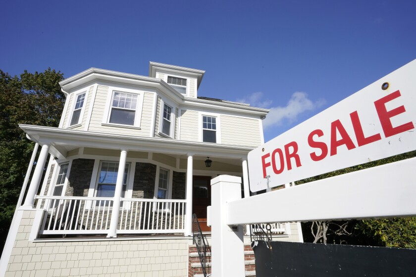 A for sale sign stands in front of a house, Tuesday, Oct. 6, 2020, in Westwood, Mass. U.S. long-term mortgage rates changed little this week, flattening in recent weeks following a year-long decline amid economic anxiety in the recession set off by the coronavirus pandemic. (AP Photo/Steven Senne)