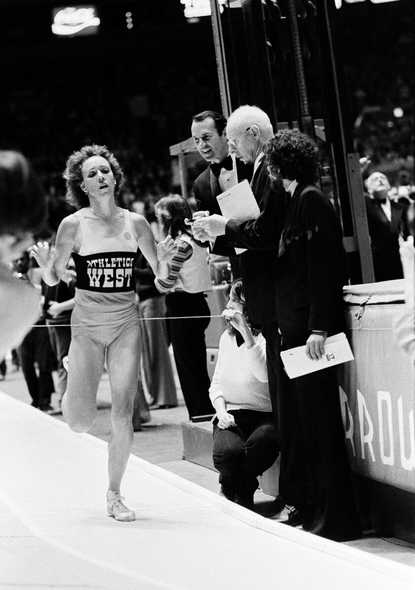 Mary Decker crosses the finish line at the Millrose Games in New York to win the women's 1,500 meters on Feb. 9, 1980.