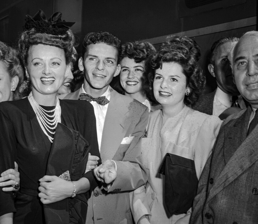 Aug. 11, 1943:  Frank Sinatra with unidentified friends arrives by train in Pasadena.