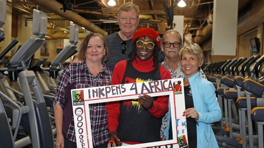 Kiro, center, poses with his gym friends and donors, Vikki LePou, bottom right, a 24 Hour Fitness pe