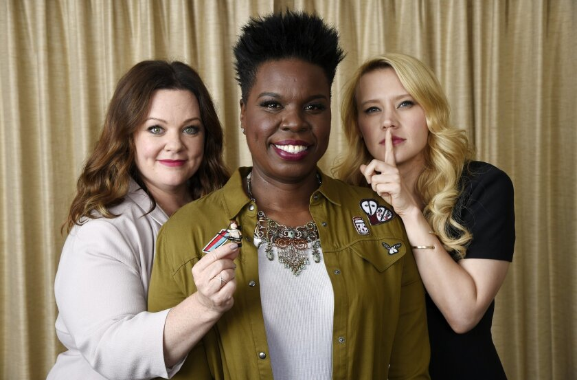 "In this July 8, 2016 photo, Melissa McCarthy, left, Leslie Jones, center, and Kate McKinnon, cast members in ""Ghostbusters,"" pose with a Lego toy figure representing fellow cast member Kristen Wiig during a portrait session at the Four Seasons Hotel in Los Angeles. Their film will be released on Fr"