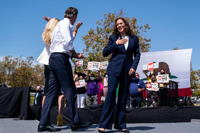 Vice President Kamala Harris is greeted by California Gov. Gavin Newsom and First Partner Jennifer Siebel Newsom.