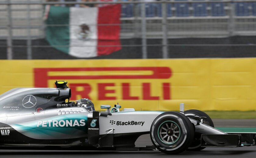 Mercedes driver Nico Rosberg of Germany drives his car during the third practice session for the Formula One Mexico Grand Prix auto race at the Hermanos Rodriguez racetrack in Mexico City, Saturday, Oct. 31, 2015. (AP Photo/Moises Castillo)