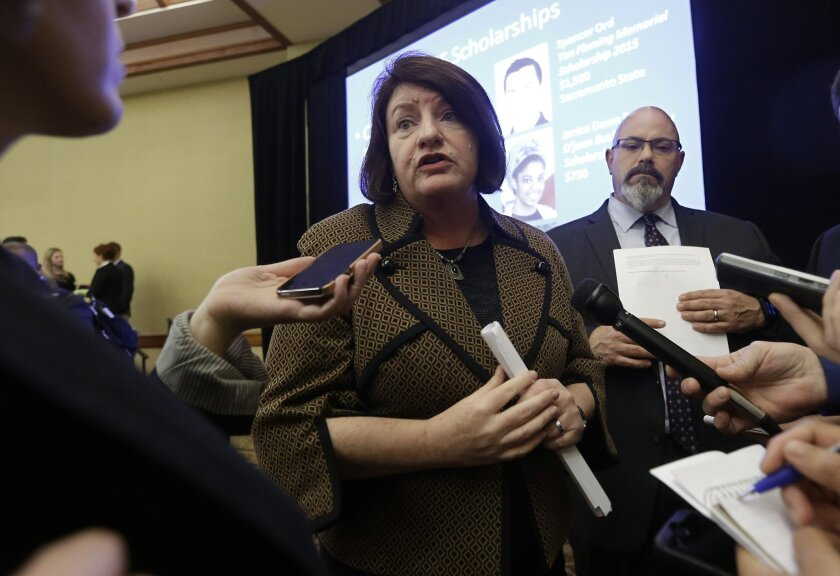 Assembly Speaker Toni Atkins, D-San Diego, talks with reporters about the transportation funding plan she unveiled during her appearance before California Transportation Foundation's 16th Annual Forum, in Sacramento, Calif., Wednesday Feb. 4, 2015. Atkins plan calls for raising $2 billion a year , including from an annual road user charge for drivers that would pay for repairs to the state's crumbling roads, bridges and highways. (AP Photo/Rich Pedroncelli)