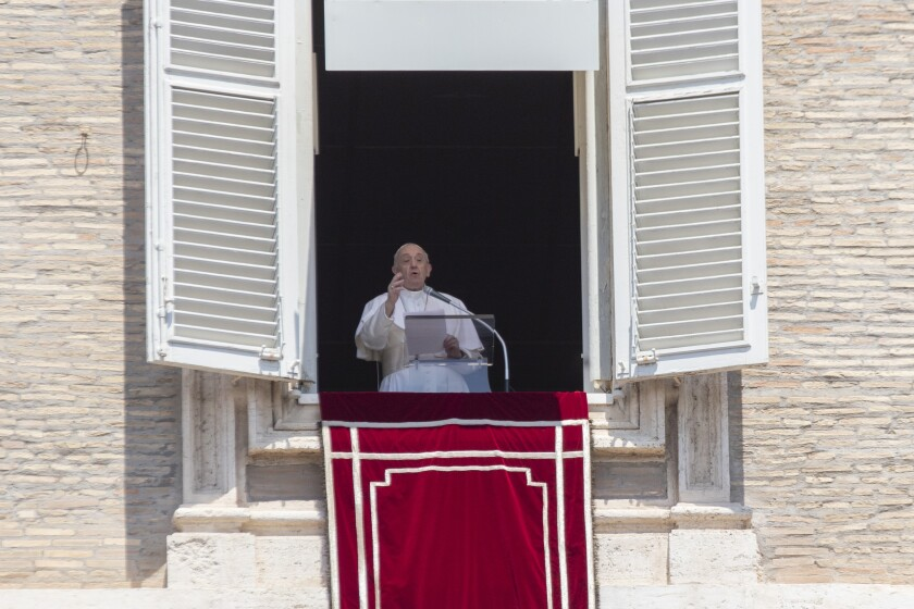 Pope Francis delivers his message from the window of his studio  overlooking St. Peter's Square at the Vatican on Sunday.