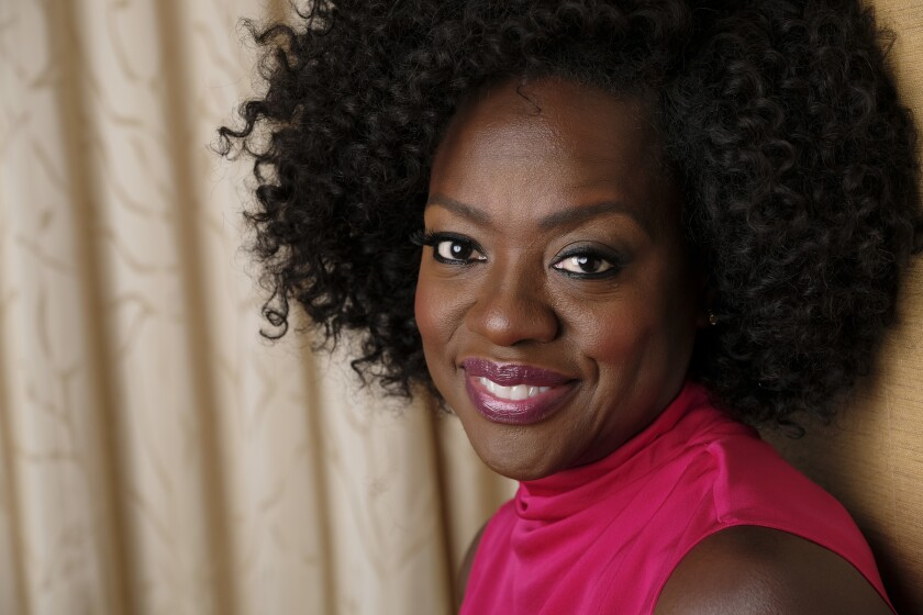 """FILE - In this Sept. 9, 2018, file photo, Viola Davis poses for a portrait at the Ritz-Carlton Hotel during the Toronto International Film Festival in Toronto. The new issue of """"Vanity Fair,"""" featuring a powerful image of Oscar-winning actor Davis, marks the first time the publication has featured the work of a Black photographer on its cover. The issue hits newsstands on July 21, 2020. (Photo by Chris Pizzello/Invision/AP, File)"""