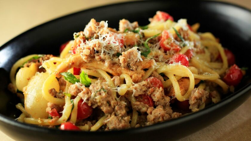 Spaghetti With Sausage, Cippolini, Chanterelle and Cherry Tomato, created by Joe Magnanelli.